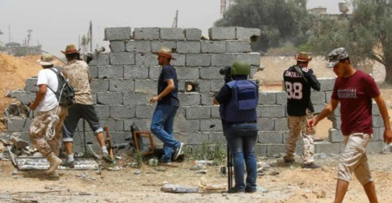 Media professionals in Libya still face censorship, intimidation and threats to their lives.  By Mahmud TURKIA (AFP/File)