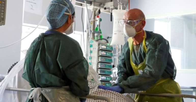 Medical staff in intensive care routinely wear full protective equipment.  By Steve Parsons (POOL/AFP/File)
