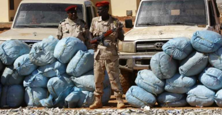 Members of Rapid Support Forces (RSF), Sudan's controversial counter-insurgency unit, show on November 5, 2017 in Khartoum sacks of hashish that were captured in the state of South Darfur a week earlier.  By ASHRAF SHAZLY (AFP)