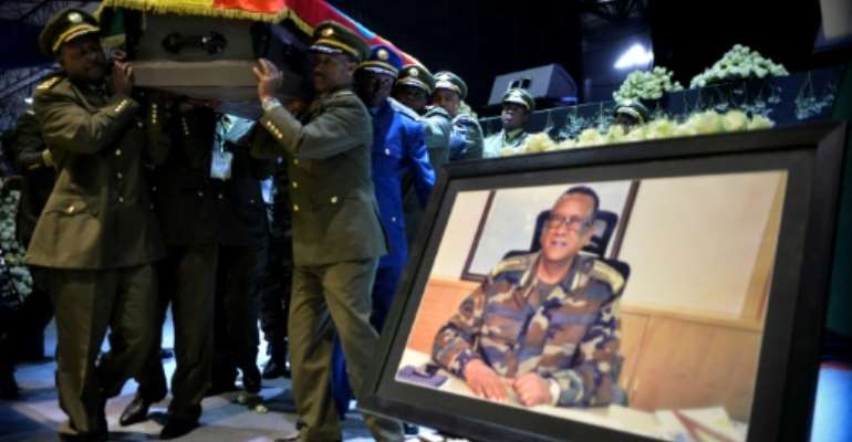 Members of the public and the military gathered in Addis Ababa on Monday for ceremonies to honour slain armed forces chief Seare Mekonnen.  By Michael TEWELDE (AFP)