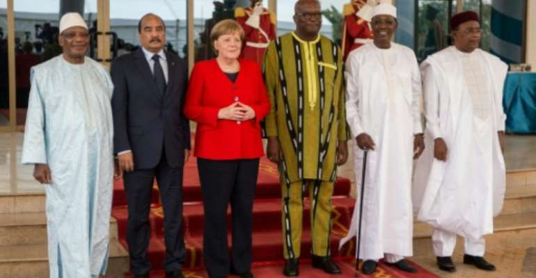 Merkel attended a G5 meeting of Sahel country leaders in Ouagadougou.  By OLYMPIA DE MAISMONT (AFP)