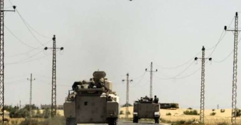 Egyptian soldiers and a military helicopter are seen in the area near the Rafah border crossing, on May 21, 2013.  By  (AFP/File)