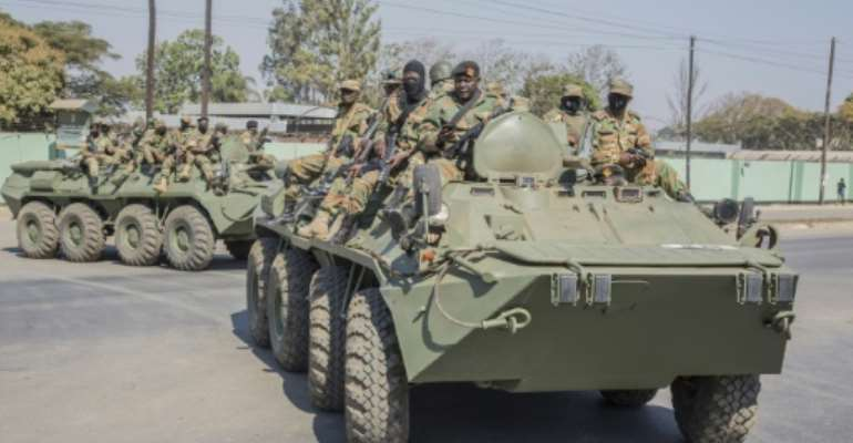 Military: Armoured personnel carriers on the streets of Lusaka on Tuesday.  By SALIM DAWOOD (AFP)