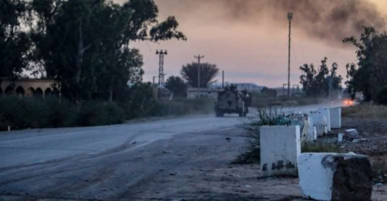 Military strongman Khalifa Haftar's self-proclaimed Libyan National Army (LNA) says it has seized a barracks in the Aziziya area south of Tripoli.  By - (LNA War Information Division/AFP)