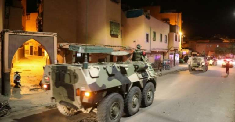 Military vehicles patrol the streets in the Moroccan city of Marrakesh to help enforce the government's order for people to stay at home amid the coronavirus COVID-19 pandemic.  By - (AFP)