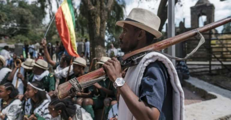 Militiaman Tesfahun Mande strolled through the streets of Gondar yelling chants in praise of Amhara fighters who took on the TPLF.  By EDUARDO SOTERAS (AFP)