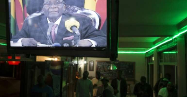 Millions of Zimbabweans tuned in to Mugabe's TV announcement on November 19 -- but he confounded expectations that he would step down.  By STR (AFP)