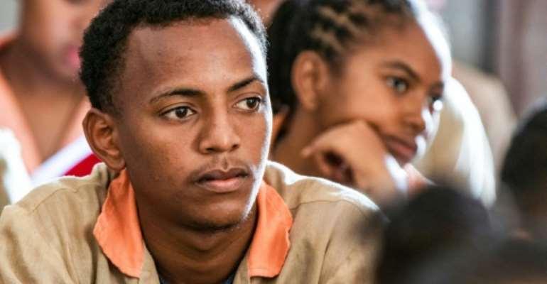 Mixed class: Michael Beafara, a Muslim pupil at St. John's - a Catholic high school in Antsiranana.  By Fita Fanomezantsoa (AFP)