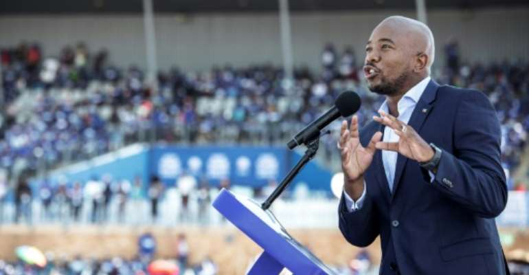 Mmusi Maimane, the leader of South Africa's main opposition party, the Democratic Alliance, tells supporters next week's general election is a chance to bring change after 25 years of disappointing ANC rule.  By GIANLUIGI GUERCIA (AFP)