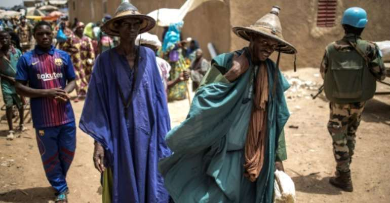 Moderate Malian imams worry jihadists are using mobile phone technology to recruit among Fulani herder community.  By Marco LONGARI (AFP)