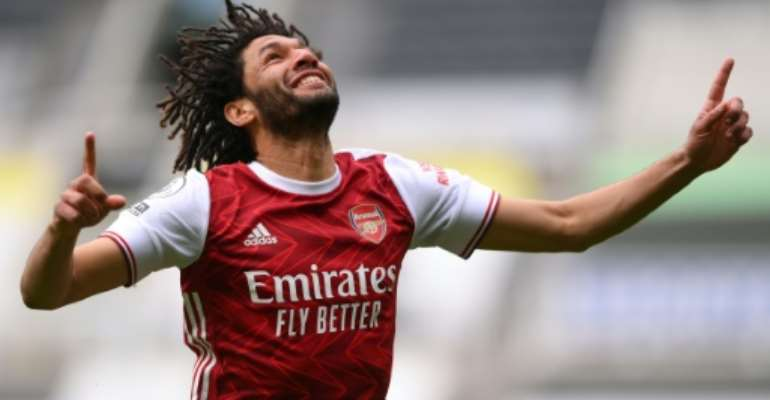 Mohamed Elneny celebrates after putting Arsenal ahead in a 2-0 victory at Newcastle.  By STU FORSTER (POOL/AFP)