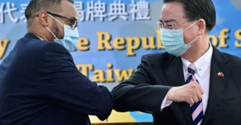 Mohamed Hagi (left), Somaliland's new representative to Taiwan bumps elbows with Foreign Minister Joseph Wu.  By Sam Yeh (AFP)