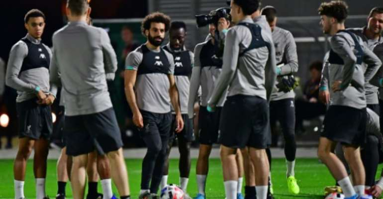 Mohamed Salah (C) at a Liverpool training session in Doha ahead of the FIFA Club World Cup.  By Giuseppe CACACE (AFP)