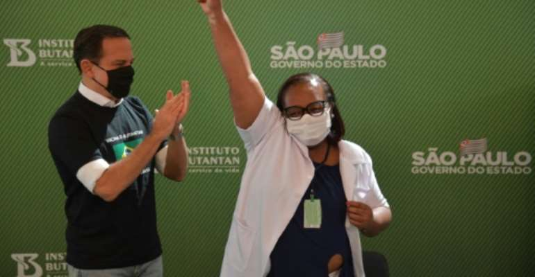 Monica Calazans, a 54-year-old nurse in Sao Paulo became the first person in Brazil to receive the Chinese CoronaVac jab after two vaccines were approved.  By NELSON ALMEIDA (AFP)