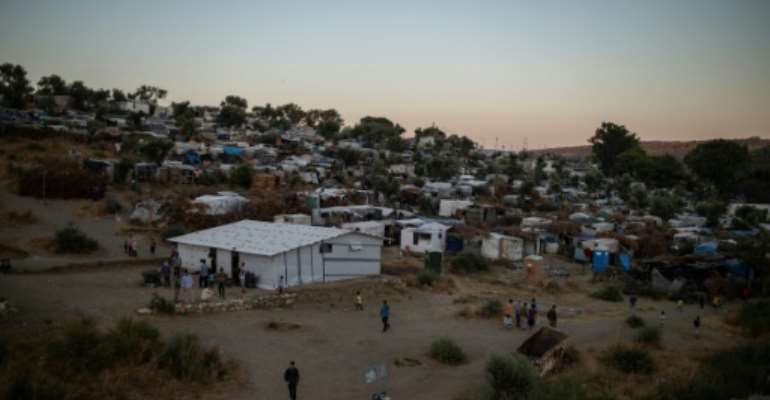More than 12,700 people live in Moria, which has a nominal capacity for fewer than 2,800..  By ANGELOS TZORTZINIS (AFP/File)