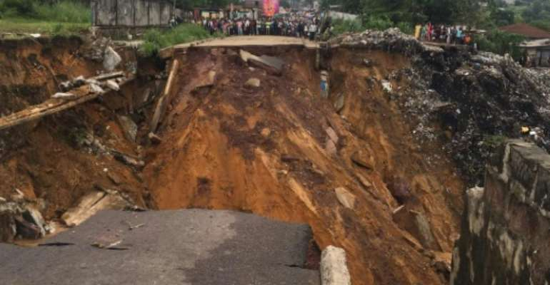 More than 40 people were killed after torrential rains caused landslides and led to rivers bursting their banks.  By Manu Kalombo (AFP)