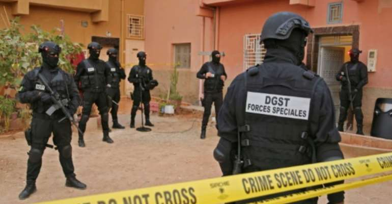 Moroccan counter-terrorism forces gather outside a house in the southern city of Errachidia on September 14, 2021.  By - (AFP)