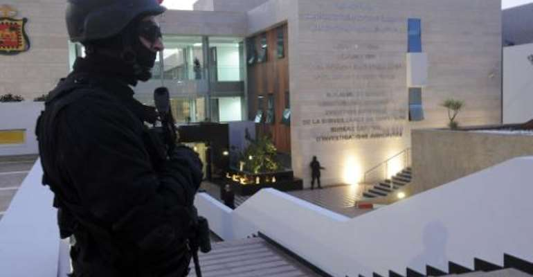 A member of the Moroccan special forces guard stands outside of the Central Bureau of Judicial Investigation (BCIJ) building on March 23, 2015 during a press conference by the governor of the BCIJ in Rabat.  By  (AFP/File)