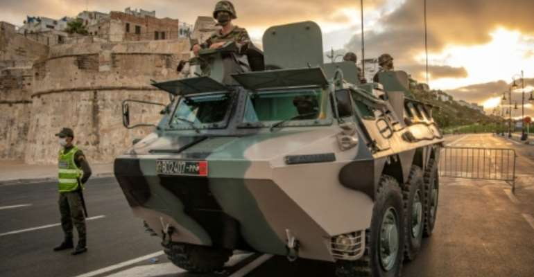 Moroccan soldiers patrol the city of Tangiers in August amid a new outbreak of the novel coronavirus.  By FADEL SENNA (AFP)