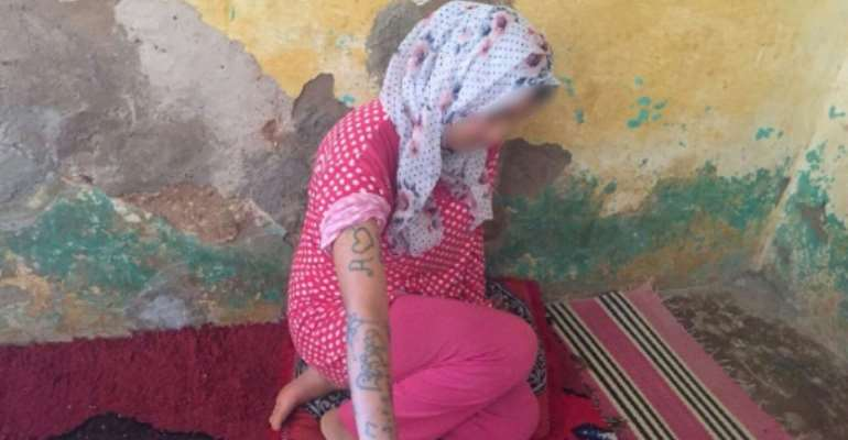 Moroccan teenager Khadija Okkarou showed tattoos that she said were carved into her body by her attackers in a video posted online.  By STRINGER (AFP/File)