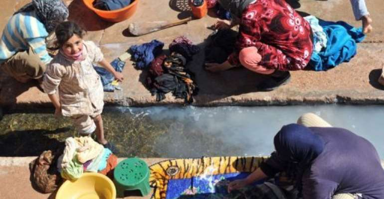 Residents of Imiter, Morocco, wash clothes at the village wash-house.  By Abdelhak Senna (AFP)