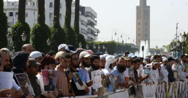 Supporters of jailed Salafists shout slogans and hold placards during a demonstration in front of the parliament in Rabat on May 16, 2014.  By Fadel Senna (AFP/File)