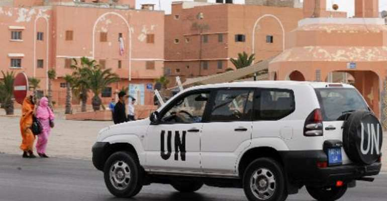A United Nations car drives past the Mechouar square on May 14, 2013 in Laayoune, the capital of Moroccan-controlled Western Sahara.  By Fadel Senna (AFP/File)