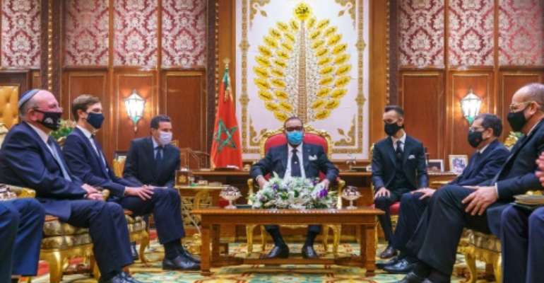 Morocco's King Mohammed VI (center)  meets in December 2020 with a US delegation led by Jared Kushner, President Donald Trump's son-in-law and advisor who had encouraged Morocco to normalize relations with Israel.  By - (Moroccan Royal Palace/AFP/File)