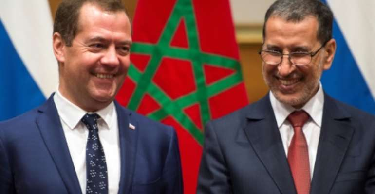 Morocco's Prime Minister Saadeddine El Othmani (R) meets his Russian counterpart Dmitri Medvedev in Rabat on October 11, 2017.  By FADEL SENNA (AFP)