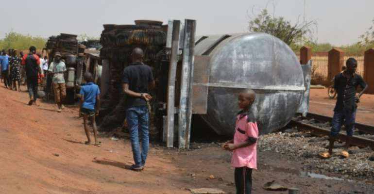 Most of the victims were trying to collect split fuel flowing from the overturned truck when the blast occurred.  By Boureima HAMA (AFP/File)