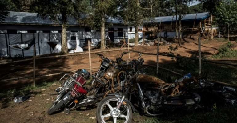 Motorbikes burnt during an attack outside an Ebola treatment centre in Butembo, the epicentre of the  latest outbreak.  By JOHN WESSELS (AFP/File)