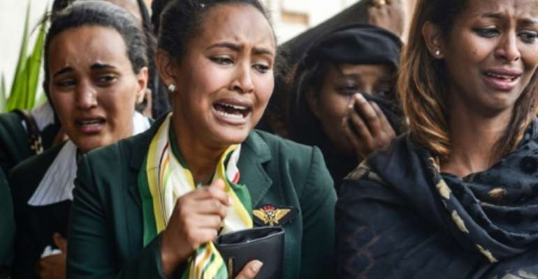 Mourners attend the funeral at Holy Trinity Cathedral in Addis Ababa, Ethiopia, for 17 Ethiopians including the eight-person flight crew killed in the crash of an Ethiopian Airlines Boeing 737 MAX 8.  By - (AFP)