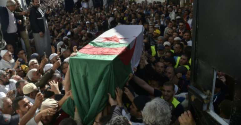 Mourners gathered for the funeral of Abassi Madani, founder of Algeria's Islamic Salvation Front.  By RYAD KRAMDI (AFP)