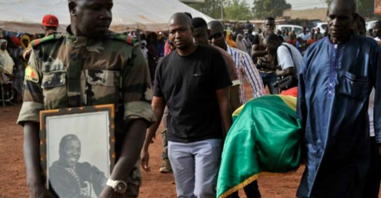 The send off for Malian photographer Malick Sidibe, whose coffin was draped in the national flag, took place in a working class neighbourhood of Bamako, with soldiers giving the iconic artist full honours.  By Habibou Kouyate (AFP)
