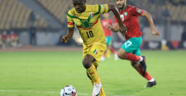 Moussa Kone (L) of Mali is pursued by Abdelmounaim Boutouil of Morocco during the African Nations Championship final in Yaounde Sunday..  By Daniel BELOUMOU OLOMO (AFP)