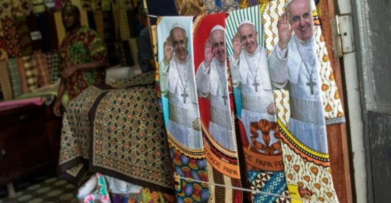 Mozambicans have been splurging on pope-related regalia.  By GIANLUIGI GUERCIA (AFP/File)