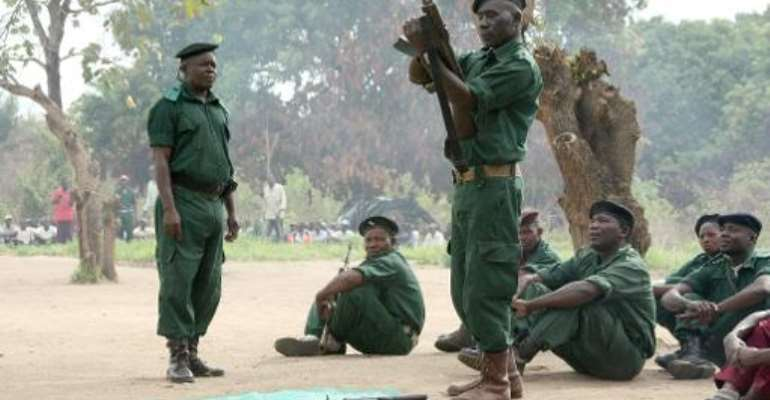 A file photo taken on November 8, 2012 shows fighters of the former Mozambican rebel movement