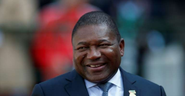 Mozambique's President Filipe Nyusi, pictured in May 2019, held a ceremony with Anadarko executives.  By SIPHIWE SIBEKO (POOL/AFP/File)