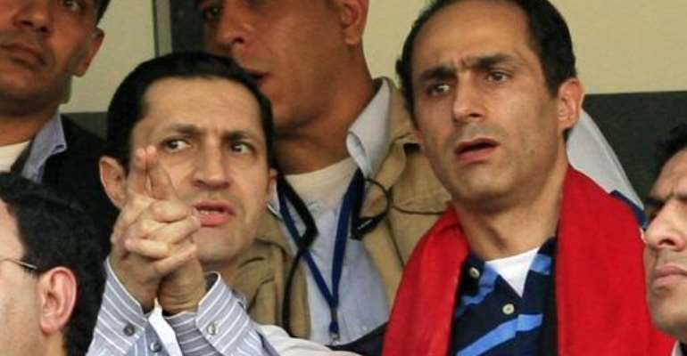 Alaa (L) and Gamal Mubarak, sons of Egyptian president Hosni Mubarak, pictured in January 2010.  By Khaled Desouki (AFP/File)