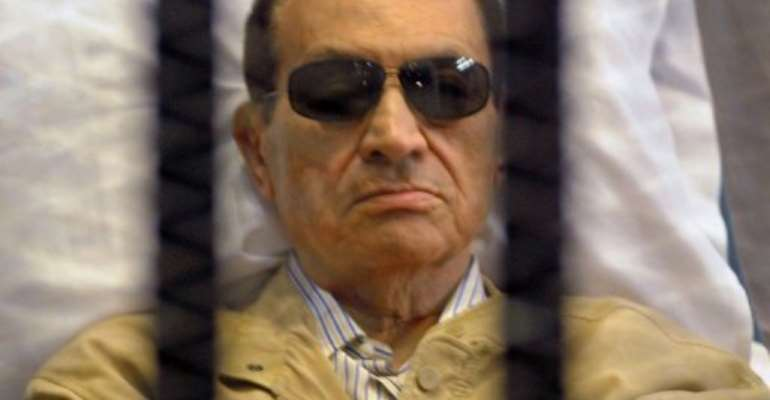Ousted Egyptian president Hosni Mubarak sits in a cage in court during his verdict hearing in Cairo on June 2, 2012.  By  (AFP/File)