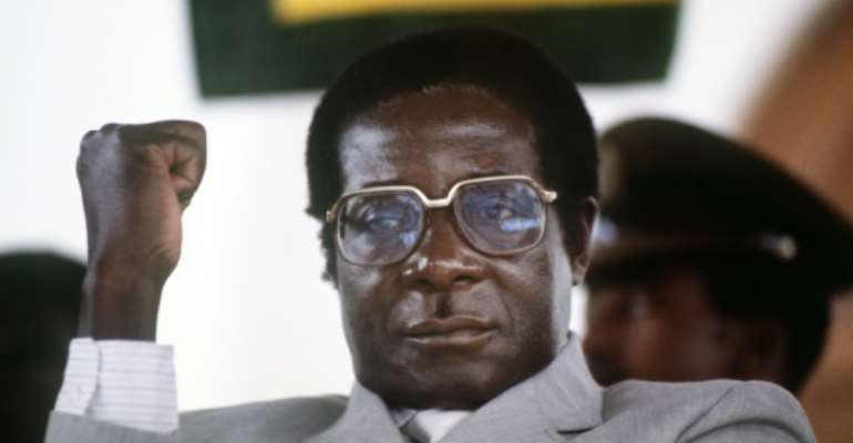 Mugabe, pictured in July 1984 at the height of his 37 years in power.  By ALEXANDER JOE (AFP)