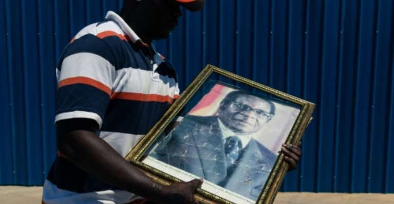 Mugabe supporters gathered at Harare airport for the return of his remains.  By Jekesai NJIKIZANA (AFP)