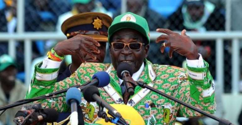 Zimbabwe's President Robert Mugabe addresses at a rally in Harare on July 28, 2013.  By Alexander Joe (AFP/File)