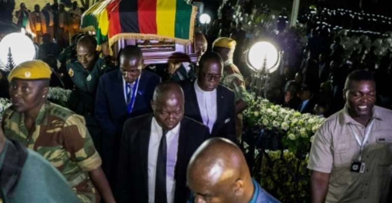 Mugabe's body arrived from Singapore on Wednesday in Harare where he was given an honour guard.  By Zinyange Auntony (AFP)