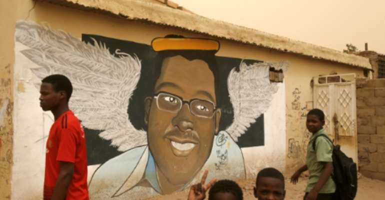 Mural portraits of slain demonstrators that became one of the symbols of the popular uprising that toppled veteran Sudanese president Omar al-Bashir, are now under threat as the military attempts to whitewash its memory, the protest movement says.  By ASHRAF SHAZLY (AFP/File)