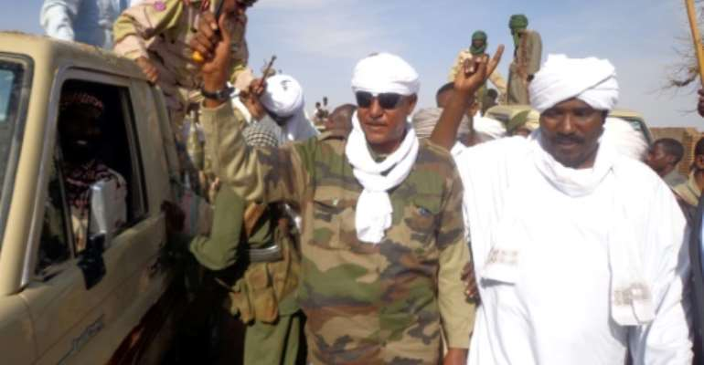 Musa Hilal (C), the leader of the Arab Mahamid tribe in Sudan's Darfur region, salutes followers in Nyala, the capital of South Darfur state, on December 7, 2013.  By - (AFP/File)