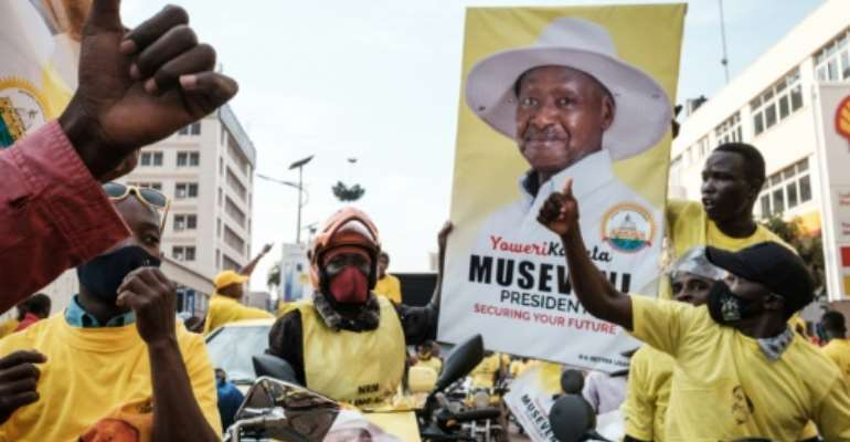 Museveni supporters in Kampala celebrated after his victory was announced on Saturday.  By Yasuyoshi CHIBA (AFP)