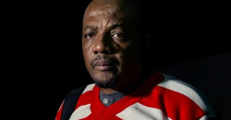 Musical protest: Zimbabwean investigative journalist Hopewell Chin'ono.  By Jekesai NJIKIZANA (AFP)