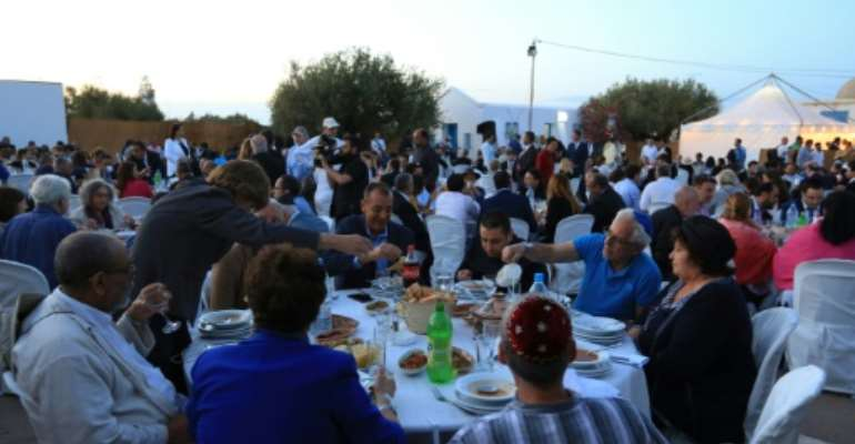 Muslim and Jewish leaders shared a fast-breaking meal on the Tunisian island of Djerba.  By FATHI NASRI (AFP)