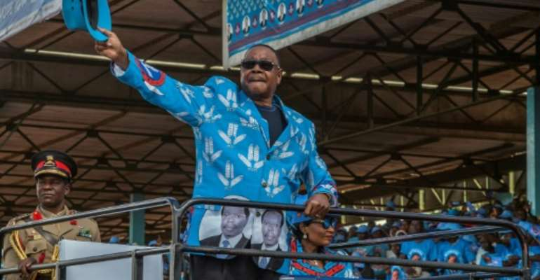 Mutharika salutes the crowd at the launch of his party manifesto in April.  By AMOS GUMULIRA (AFP/File)